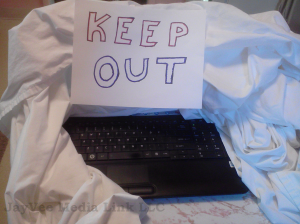 covered up computer monitor with KEEP OUT sign