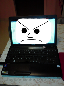 computer with angry face on monitor