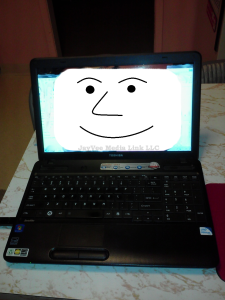 computer with happy face on monitor