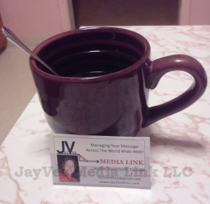 coffee cup with business card
