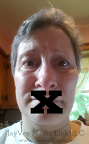 face with x over mouth